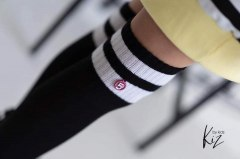 Black socks with white stripes and a pendant