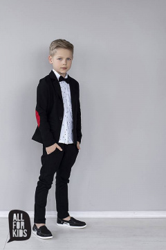 Elegantly sporty black suit with bow tie and red patches