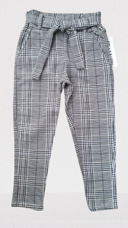 Elegantly sports a shepherd's Plaid pants with decorative bow
