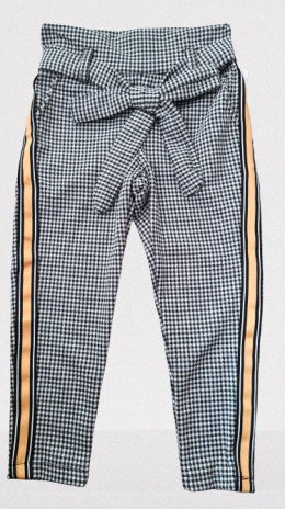 Elegantly sports a shepherd's Plaid pants with decorative tape and bow